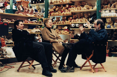 Stanley Kubrick, 'Eyes Wide Shut, directed by Stanley Kubrick (1999; GB/United States). Tom Cruise, Nicole Kidman, and Stanley Kubrick during a break in shoot on the set.', 1999