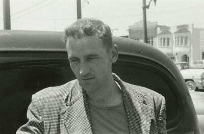 Allen Ginsberg, 'Neal Cassady, young and handsome age 29, checking out cars in North Beach used car lot, San Francisco'