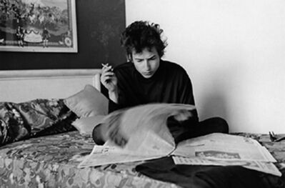 Daniel Kramer, 'Bob Dylan Reading the Newspaper in a Hotel Bed, Philadelphia', 1964