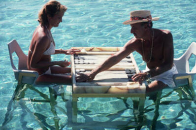 Slim Aarons, 'Keep your Cool, 1978: Carmen Alvarez enjoying a game of backgammon with Frank Brandstetter in a swimming pool in Acapulco, Mexico ', 1978