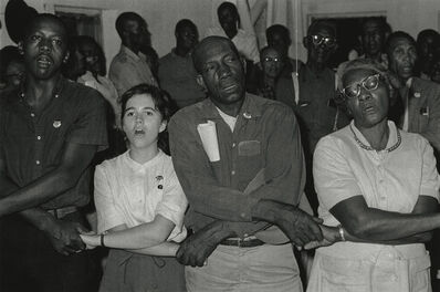 "Bob Adelman, '""In West Feliciana, an overwhelmingly black parish where no person of color had voted in the twentieth century, volunteer Mimi Feingold urged members of a church congregation to try to vote. She then joined hands with them to sing, 'This Little Light of Mi""', 1963"