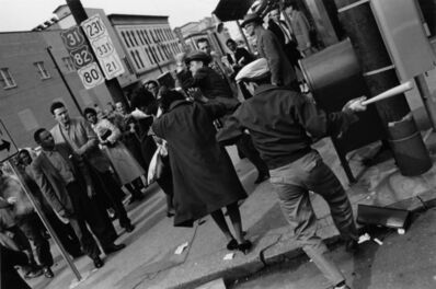 Charles Moore, 'A white man swings a baseball bat at a shopper, while another strikes a black woman in the background. The attack in 1960 occurred the day after black students were refused service in the whites-only cafeteria at the state capitol', 1960