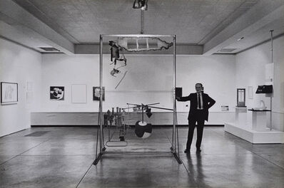 Julian Wasser, 'Marcel Duchamp standing with The Large Glass, Duchamp Retrospective, Pasadena Art Museum,', 1963