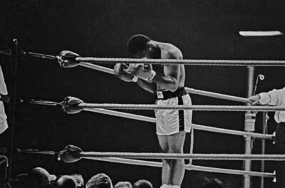 Thomas Hoepker, 'Muhammad Ali prays to Allah before the first round of a title fight', 1966