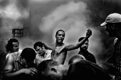 Paolo Pellegrin, 'A man searches for his daughter's body in rubble moments after an Israeli air strike levelled their apartment building in southern Beirut, Lebanon. ', 2006