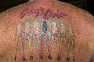 Lauren Greenfield, 'Norbert Aleman, 73, shows off his Crazy Girls tattoo, the logo of the long-running topless revue he produces, Las Vegas', 2013