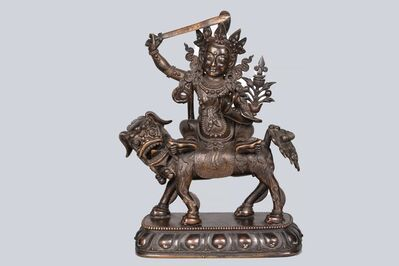 Bronze Sculpture, 'A Patinated Bronze Figure of Manjushri riding a Dragon, China, Ming Dynasty, 19 cm.'