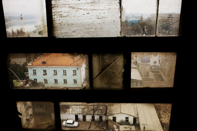 "Carolyn Drake, 'Khujand viewed through a window in the Leninabad Hotel. The city was established by Alexander the Great 2,500 years ago on the banks of the Syr Darya (framed in the upper left corner). From ""Two Rivers""', 2009"