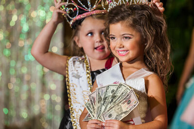 "Lauren Greenfield, 'Kailia Deliz, 5, receiving her cash award for winning the Ventura County ""Summer Fun"" Beauty Pageant, Oxnard California, ED 1/5', 2011"