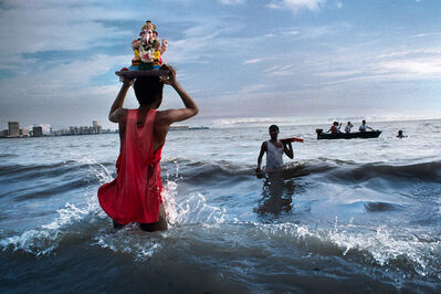 Steve McCurry, 'Devotee carries statue of Lord Ganesh into the waters of the Arabian Sea during the immersion ritual off Chowpatty beach, Mumbai, India', 1993