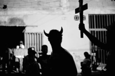 """Christopher Anderson, 'A man in a devil costume runs around the streets of La Vega before a rally for Chavez. The act is to make fun of the idea of the """"red devil of socialism"""" (Caracas, Venezuela)', 2006"""