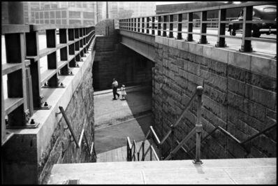 Erich Hartmann, 'Man and girl walk past the entrance of the Brooklyn Bridge. New York City, USA.', 1955