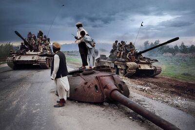 Steve McCurry, 'Men Watch as Tanks Go By, Afghanistan', 1992