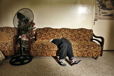 Laura Boushnak, 'The prosthetic legs of Mohammed, lie on a sofa at the Rashidiyeh camp for Palestinian refugees. Rashidiyeh, Lebanon.', 2007