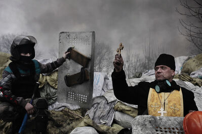 Jerome Sessini, 'An Orthodox priest blesses the protesters on a barricade. Kiev, Ukraine.', 2014