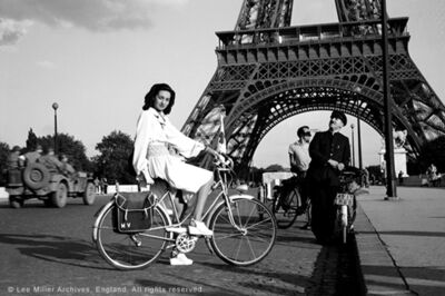 Lee Miller, 'For cycling: white rayon smocked with blue; apron-overskirt nearly meets behind, Paris, France 1944 , Paris, France', 1944