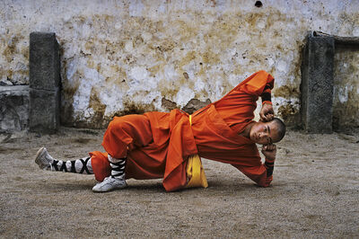 Steve McCurry, 'Young monk practicing Shaolin, one of the oldest styles of Kung Fu, Shaolin Monastery, Henan Province, China', 2004