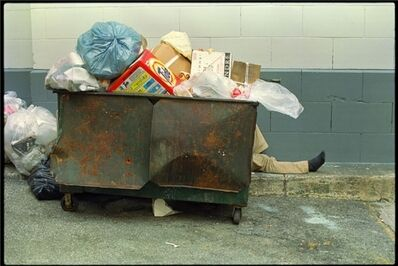 Clayton Patterson, 'Untitled (homeless behind trash container)'