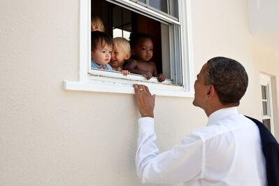 Pete Souza, 'Barack Obama greets children at a day care facility adjacent to daughter Sasha's school', 2011