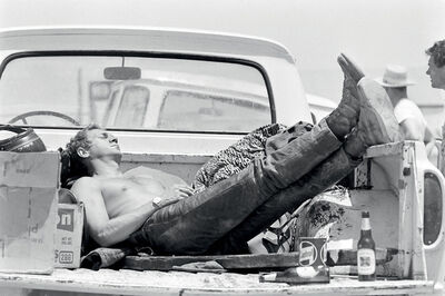 John Dominis, 'Steve McQueen sleeping in the back of his pick up truck, California', 1963