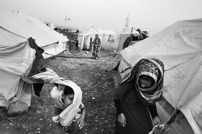 Paolo Pellegrin, 'Daily life scenes in the Arbat refugee camp near Sulaymaniya. This camp hosts roughly 15, 000 people, mainly Yazidis, Arabs and Turcomans. Kurdistan, Iraq ', 2015