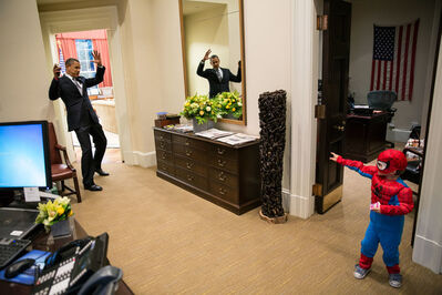 Pete Souza, 'Barack Obama pretends to be caught in Spider-Man's web outside the Oval Office on Halloween', 2012
