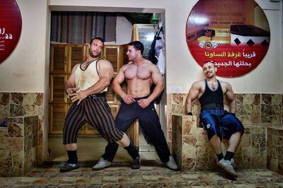 Tanya Habjouqa, 'Gazan body builders jovially strike poses after a workout', 2000