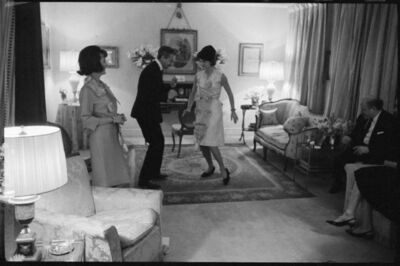 Benno Graziani, 'At her sister Lee Radziwill's flat in London, Jackie Kennedy learns how to dance the twist with designer Oleg Cassini.', 1962