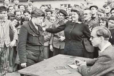 Henri Cartier-Bresson, 'Gestapo informer recognized by a woman she had denounced, Transit Camp, Dessau, Germany', 1945