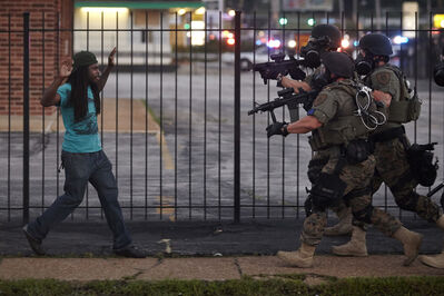 Whitney Curtis, 'Rashaad Davis, 23, backs away as St. Louis County police officers approach him with guns drawn and eventually arrest him, Ferguson, Missouri, August 11, 2014 ', 2014