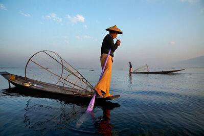 Steve McCurry, 'Fisherman Lights Cigarette on Boat', 2014