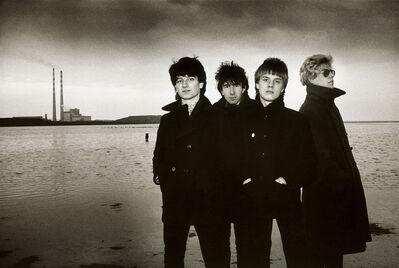 Sheila Rock, 'U2 for their 2nd single, '11 O'Clock Tick Tock', Sandymount Strand, Dublin, Ireland', 1980
