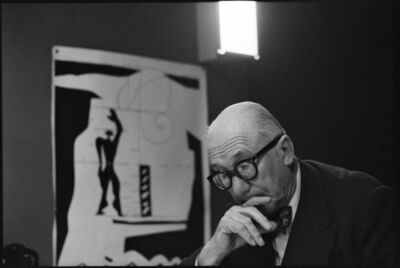 "René Burri, 'FRANCE. Ile-de-France region. Paris. 1959. 7th arrondissement. 35, rue de Sèvres.  The painter, architect and city planner LE CORBUSIER in the ""Atelier 35 S"".  On the left: a lithograph of his ""Modulor"".', 1959"