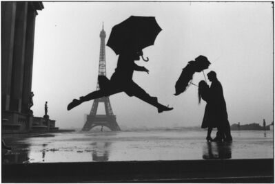 Elliott Erwitt, '13. FRANCE. Paris. (Umbrella jump)', 1989