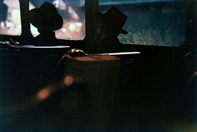 Saul Leiter, 'Untitled (two men in hats on train at night)', 1950