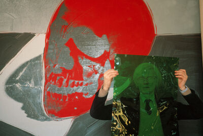 "Thomas Hoepker, 'Andy Warhol with a red skull painting in his ""Factory"" at Union Square', 1981"