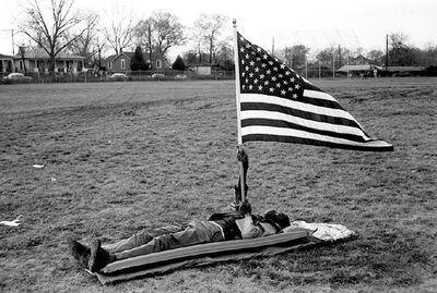 Steve Schapiro, 'Boy on the Ground with Flag', 1965