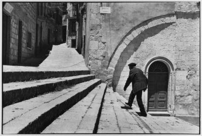 Leonard Freed, 'Man climbs stairs, Madonie Mountains, Petralina Sottana, Sicily, Italy ', 1974
