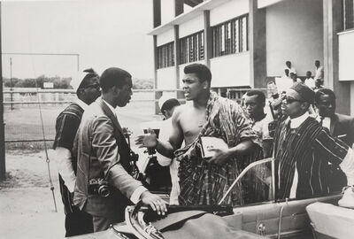 Gerry Cranham, 'Muhammad Ali retraces his roots after winning his 1st Worlds heavyweight title. See talking to photographer Howard Bingham, Ghana, 1964'