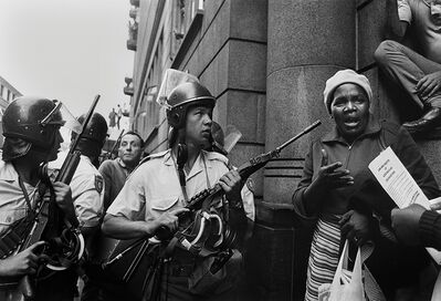 Paul Weinberg, 'Workers leaving a May Day meeting find riot police at the entrance blocking their way at the footsteps of Khotso House, May 1985', 1985