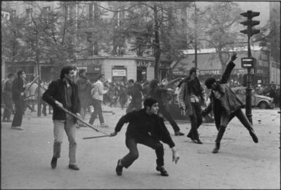 Bruno Barbey, 'Students hurling projectiles against the police. 6th arrondissement. Boulevard Saint Germain. Paris, France. ', 1968