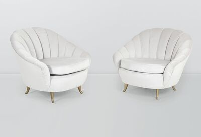 ISA, 'a pair of armchairs with a wooden structure and fabric upholstery', ca. 1950