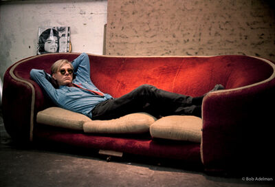 Bob Adelman, 'Andy Warhol on the red Factory couch (which was used in the 1964 film 'Couch'). Silk-screened 'Jackie' in the background ', 1965