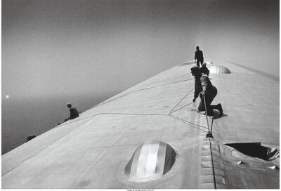 Alfred Eisenstaedt, 'Repairing the Hull of the Graf Zeppelin during the flight over the Atlantic', 1934