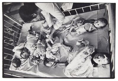 Philip Jones Griffiths, 'Orphans from the Vietnamese war in a hospital cot', c.1968