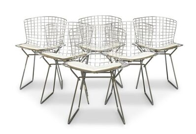 Harry Bertoia, 'a set of six 'Wire' chairs, with leather seats, together with a 'Tulip' style dining table in the manner of Eero Saarinen', c. 1960s -1970s