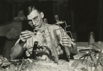 Lewis Wickes Hine, 'Worker finishing the end of a sulphur determinator. L.G. Nestor Co., Millville, NJ - (Sold as part of a set of 70 photographs)', March 26-1937