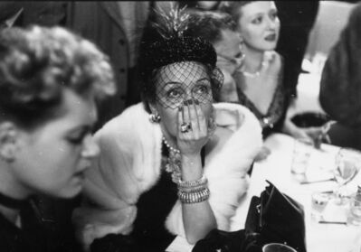 Slim Aarons, 'Gloria Swanson awaiting the results of the Academy Award for Best Actress at a cafe on West 52nd Street, New York', 1951