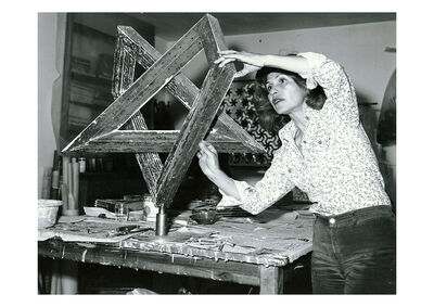 Monir Farmanfarmaian, 'Monir Shahroudy Farmanfarmaian in her studio working on Heptagon Star, Tehran, 1975', 1975