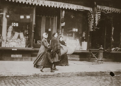 Lewis Wickes Hine, 'Woman and Girl Carrying Finished Corset Covers, Wooster Street, New York City, New York', 1912